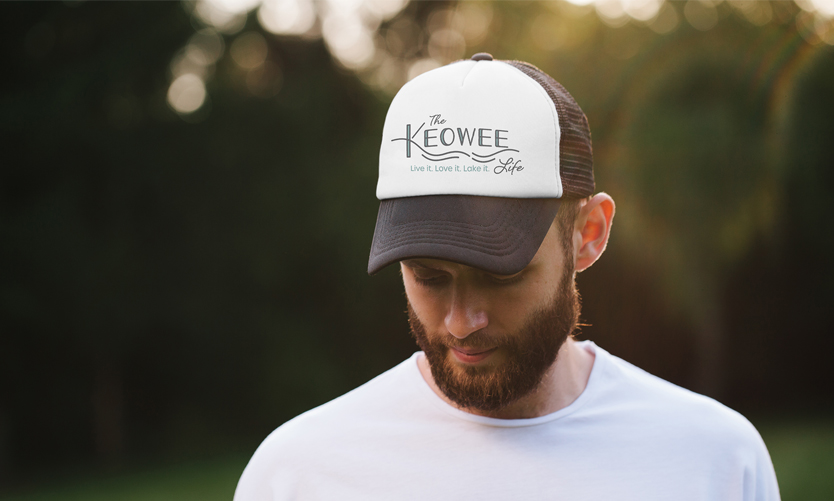 The Keowee Life branding by Annatto. Branded baseball cap.