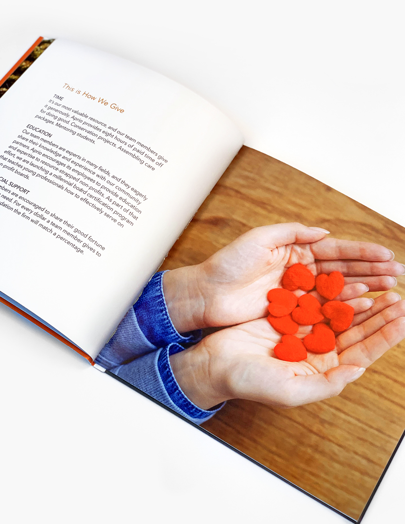 Aprio Giving Back Booklet Interior Spread - Hand Hearts