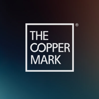 The Copper Mark Logo on Gradient Background